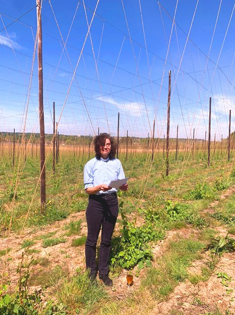 Rev. Claire Holt of St Paul's Church, Tongham, conducting this year's Hop Blessing in the Hogs Back Brewery hop garden