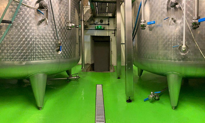 Hogs Back Brewery has literally 'gone green' by painting its brewhouse floor a bright lime hue