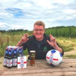 Gordon Thompson, Hogs Back Brewery sales director, has everything crossed for England's success on Sunday. Photo taken at the Brewery Tap, overlooking their hop garden.